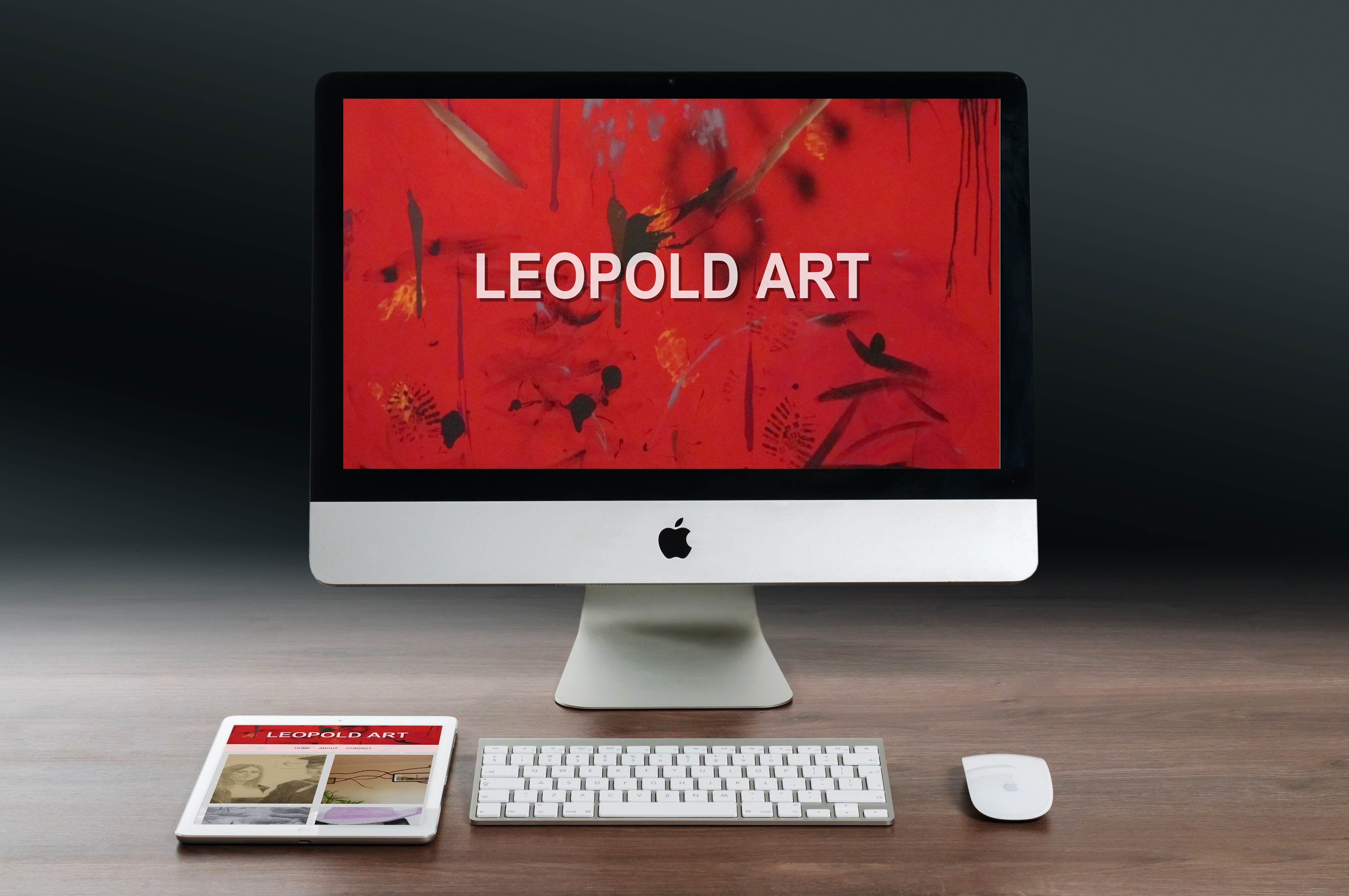 A Mac and a tablet sitting on a wooden table each displaying the same website - leopoldart.net